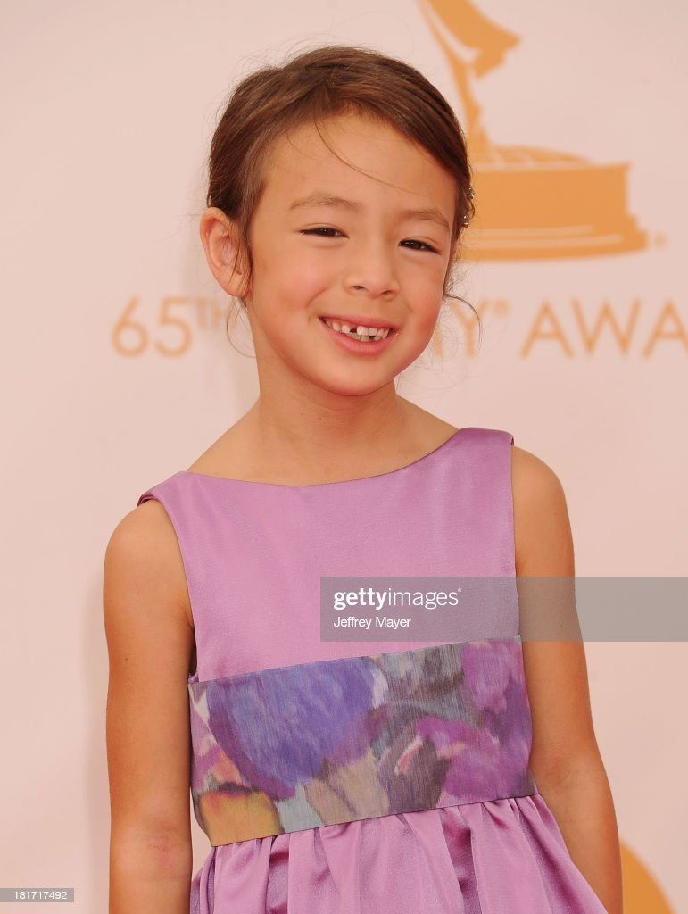 Actress Aubrey AndersonEmmons arrives at the 65th Annual Primetime Emmy Awards at Nokia Theatre LA Live on September 22 2013 in Los Angeles California