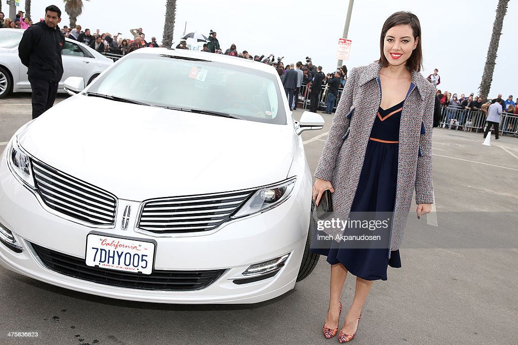 Actress Aubrey Plaza arrives in Lincoln's 2014 MKZ at 'Film Uncovered' presented by Lincoln Motor Company, honoring the Behind-The-Scenes Artisans of Independent Film, at the 2014 Film Independent Spirit Awards at Santa Monica Beach on March 1, 2014 in Santa Monica, California.