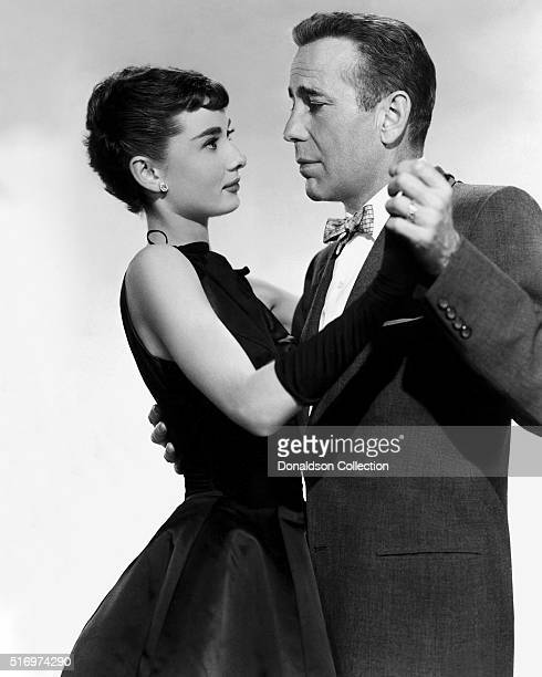 Actress Audrey Hepburn and actor Humphrey Bogart pose for a publicity still for the Paramount Pictures film 'Sabrina' in 1954 in Los Angeles...
