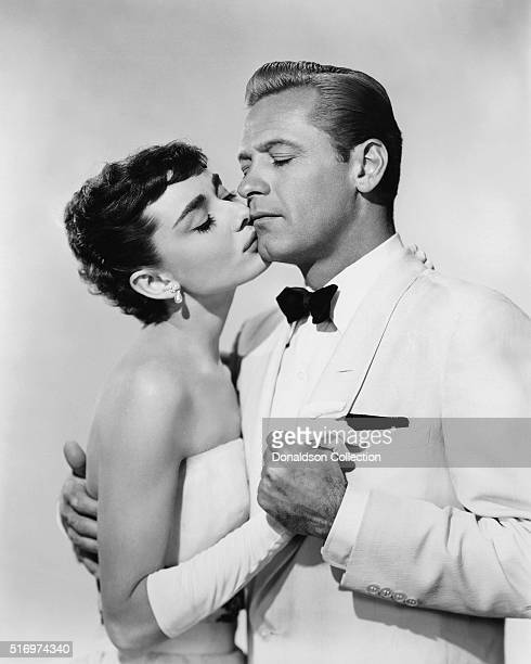 Actress Audrey Hepburn and actor William Holden pose for a publicity still for the Paramount Pictures film 'Sabrina' in 1954 in Los Angeles California