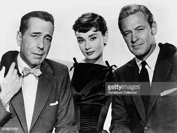 Actress Audrey Hepburn and actors Humphrey Bogart and William Holden pose for a publicity still for the Paramount Pictures film 'Sabrina' in 1954 in...
