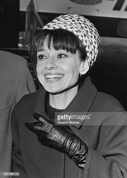 Actress Audrey Hepburn arrives at London Airport April 1964