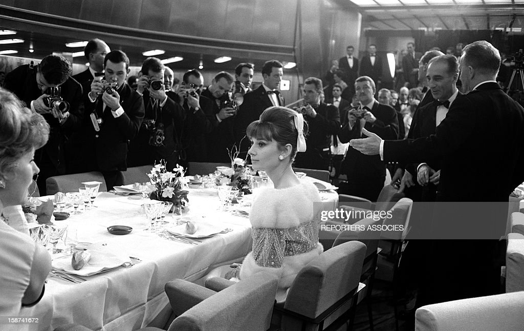Actress <a gi-track='captionPersonalityLinkClicked' href=/galleries/search?phrase=Audrey+Hepburn&family=editorial&specificpeople=86470 ng-click='$event.stopPropagation()'>Audrey Hepburn</a> at the 'Bal des Petits Lits Blancs' on board of Liner France on January, 1962 in France.