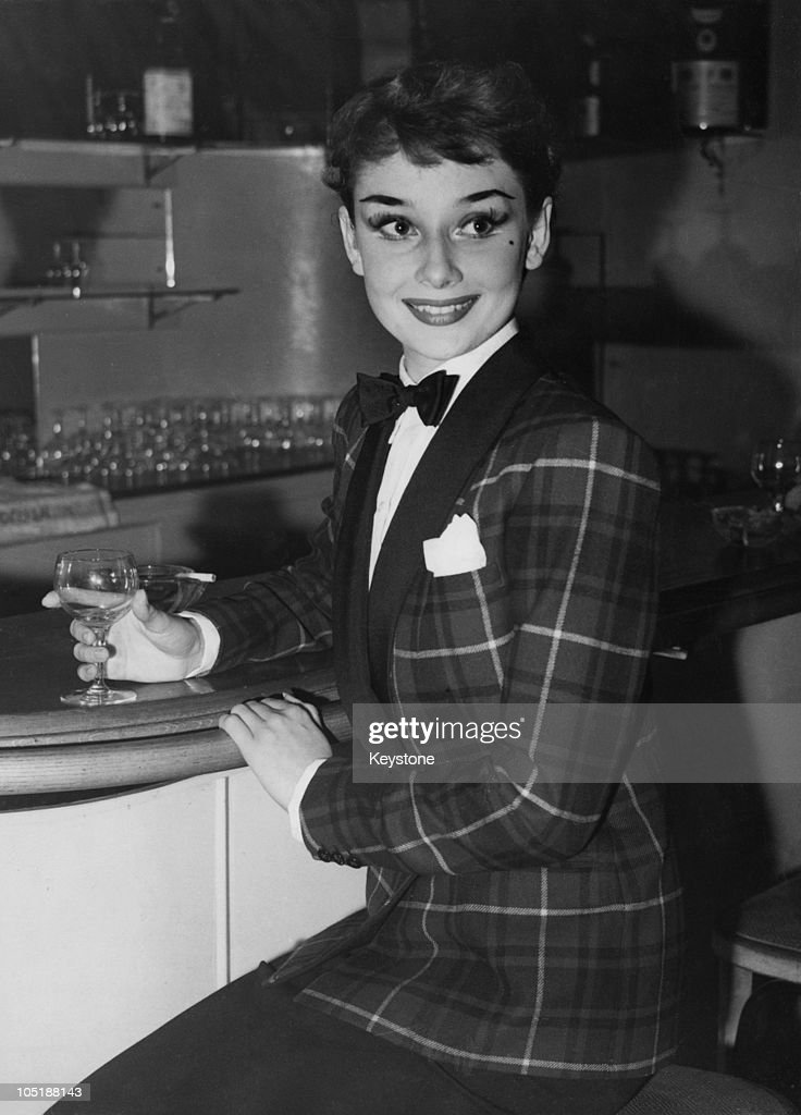 Actress Audrey Hepburn dines out in London's West End wearing a tartan jacket and bow tie 3rd October 1950