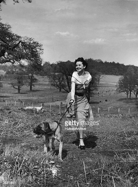 Actress Audrey Hepburn exercising her dog in Richmond Park after a strenuous season in the London revue 'Sauce Piquante' 13th May 1950 Picture Post...