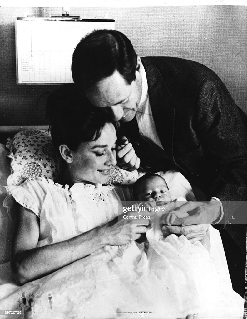 Actress Audrey Hepburn (1929-1993) with her husband, American actor Mel Ferrer (1917 - 2008) and their three-day-old son Sean, Lucerne, Switzerland, 20th July 1960.