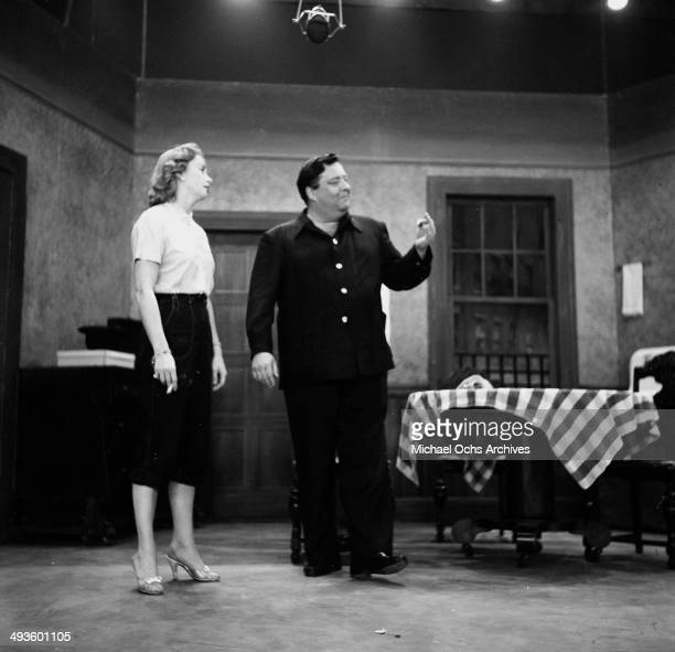 Actress Audrey Meadows and Jackie Gleason on stage during rehearsal of the 'The Jackie Gleason Show' in Los Angeles California