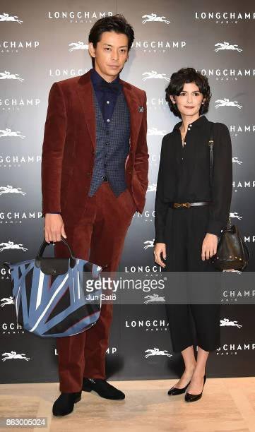 Actress Audrey Tautou and actor Atsushi attend the opening ceremony of Longchamp La Maison Omotesando flagship store on October 19 2017 in Tokyo Japan