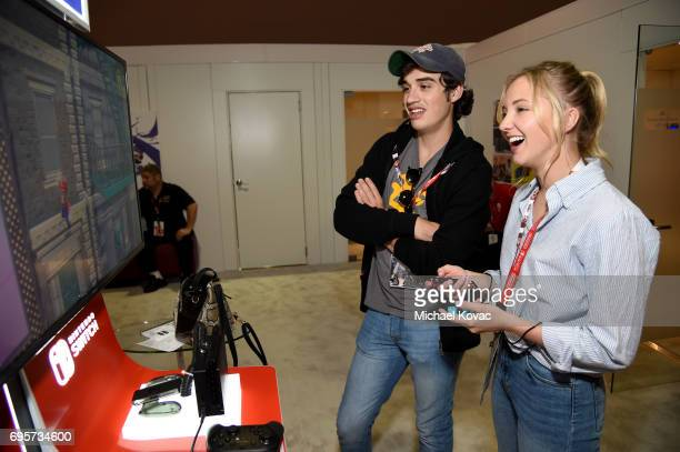Actress Audrey Whitby and actor Joey Bragg play Super Mario Odyssey at the Nintendo booth at the 2017 E3 Gaming Convention at Los Angeles Convention...