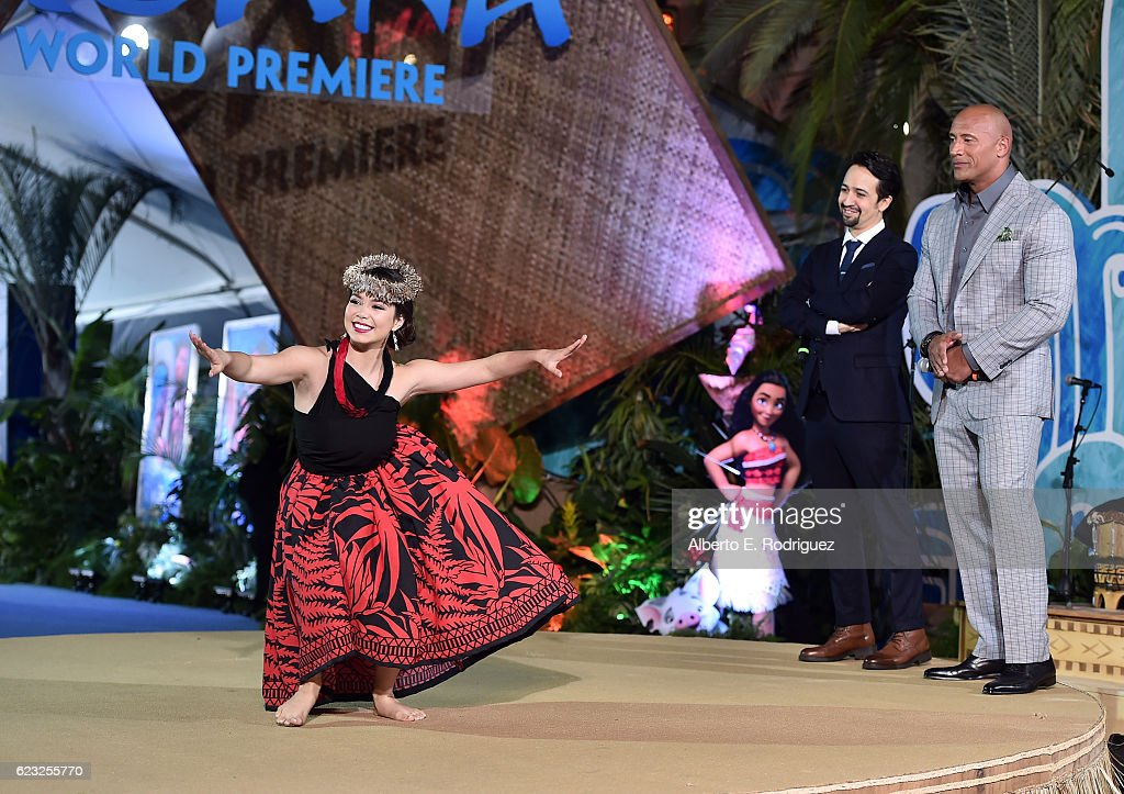 Actress Auli'i Cravalho performs onstage with songwriter Lin-Manuel Miranda and actor Dwayne Johnson at The World Premiere of Disney's 'MOANA' at the El Capitan Theatre on Monday, November 14, 2016 in Hollywood, CA.