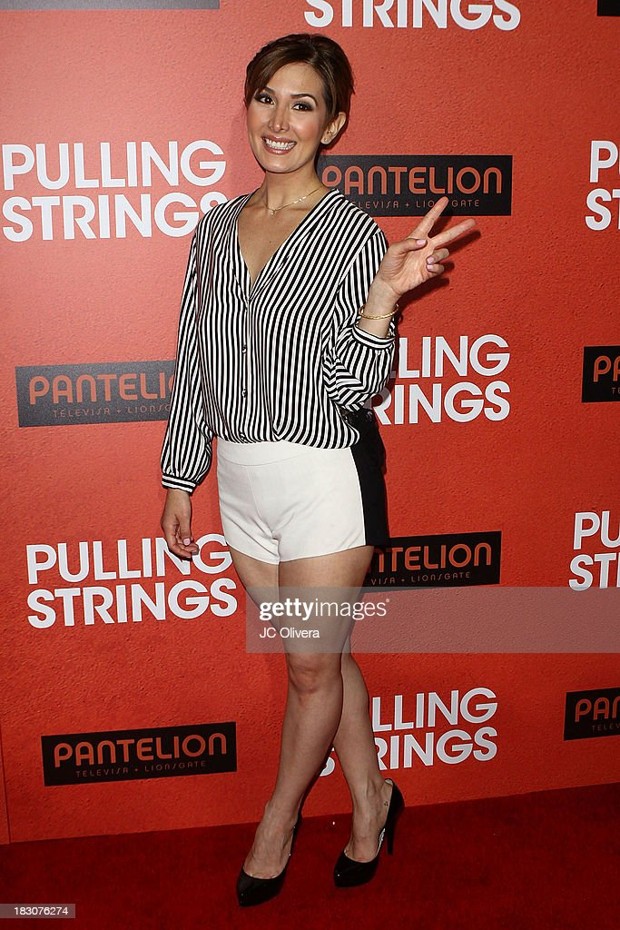 Actress Aurora Papile attends the Los Angeles Premiere of 'Pulling Strings' at Regal Cinemas L.A. Live on October 3, 2013 in Los Angeles, California.