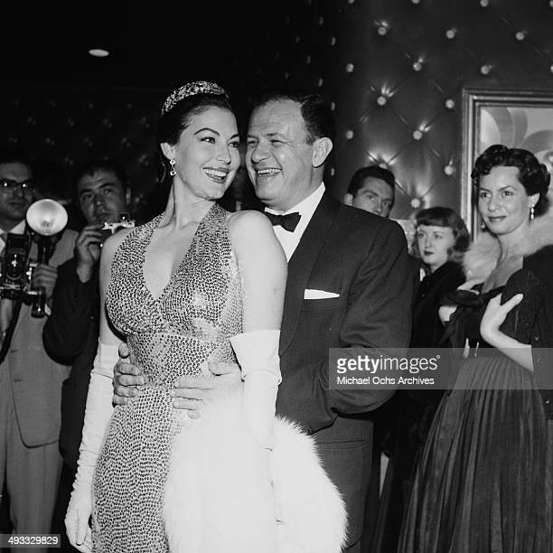Actress Ava Gardner with Director Joseph L Mankiewicz attends the premiere of 'The Barefoot Contessa' in Los Angeles California