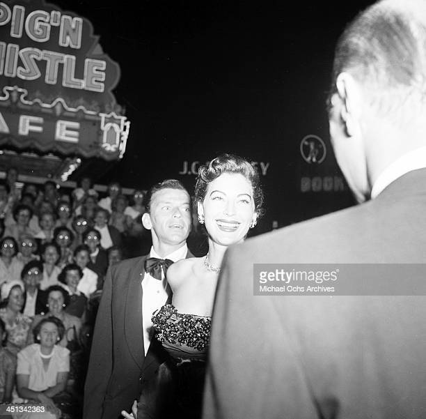 Actress Ava Gardner with Frank Sinatra attends the premiere of 'Showboat' in Los Angeles California