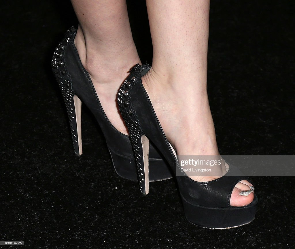 Actress Ayelet Zurer (shoe detail) attends the Dahlia Wolf Launch Party at the Graffiti Cafe on October 22, 2013 in Los Angeles, California.