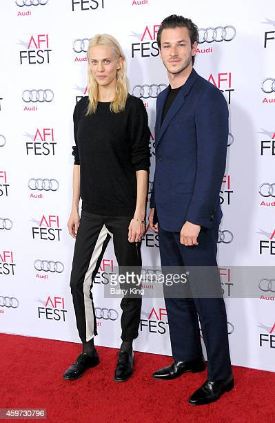 Actress Aymeline Valade and actor Gaspard Ulliel arrive at AFI FEST 2014 Presented By Audi 'Saint Laurent' Special Screening held at Dolby Theatre on...
