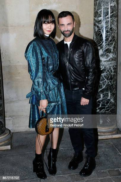 Actress Bae Doona and stylist Nicolas Ghesquiere pose after the Louis Vuitton show as part of the Paris Fashion Week Womenswear Spring/Summer 2018 on...