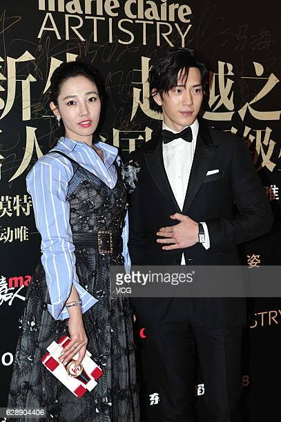 Actress Bai Baihe and actor Jing Boran arrive at the red carpet of Marie Claire Style China on December 9 2016 in Beijing China