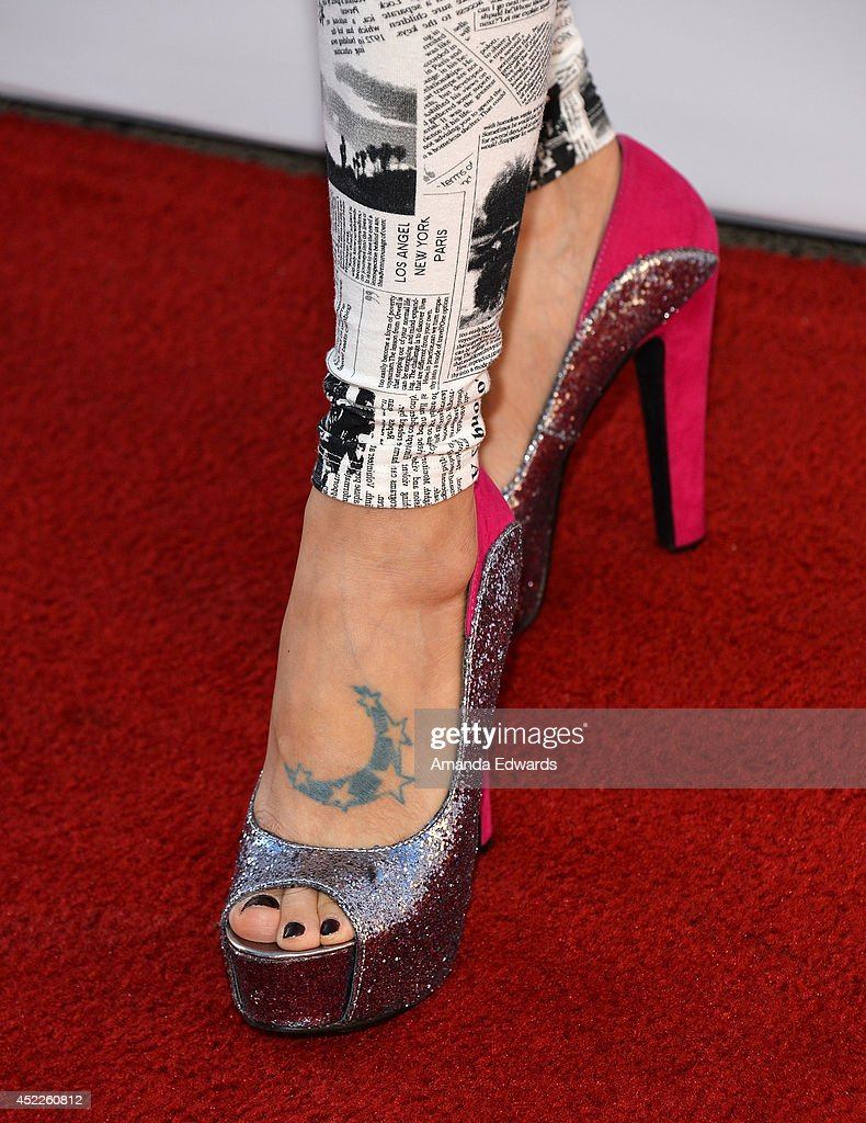 Actress <a gi-track='captionPersonalityLinkClicked' href=/galleries/search?phrase=Bai+Ling&family=editorial&specificpeople=201459 ng-click='$event.stopPropagation()'>Bai Ling</a> (shoe detail) arrives at the 4th Annual Variety - The Children's Charity of Southern CA Texas Hold 'Em Poker Tournament at Paramount Studios on July 16, 2014 in Hollywood, California.