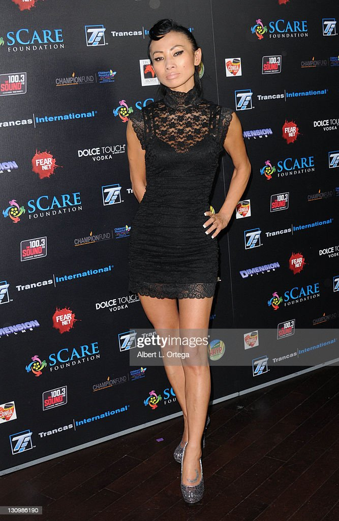 Actress <a gi-track='captionPersonalityLinkClicked' href=/galleries/search?phrase=Bai+Ling&family=editorial&specificpeople=201459 ng-click='$event.stopPropagation()'>Bai Ling</a> arrives for the sCare Foundation's 1st Annual Halloween Launch Benefit held at The Conga Room at L.A. Live on October 30, 2011 in Los Angeles, California.