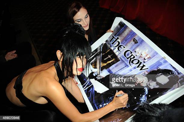 Actress Bai Ling signs memorabilla at the Nerds Like Us Presentation of 'The Crow' 20th Anniversary Midnight Screening and QA with Bai Ling held at...