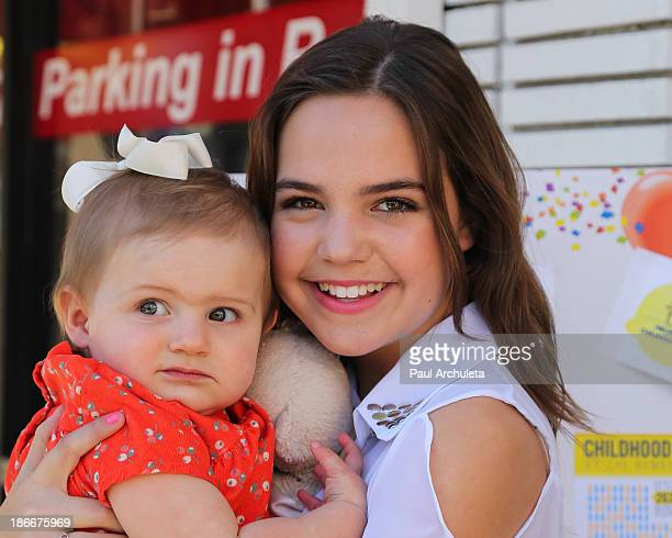Actress Bailee Madison holds her niece Riley Vilasuso at Alex's Lemonade Stand on November 2 2013 in Studio City California
