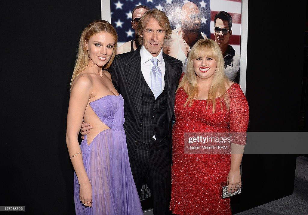 Actress <a gi-track='captionPersonalityLinkClicked' href=/galleries/search?phrase=Bar+Paly&family=editorial&specificpeople=5598732 ng-click='$event.stopPropagation()'>Bar Paly</a>, director/producer <a gi-track='captionPersonalityLinkClicked' href=/galleries/search?phrase=Michael+Bay&family=editorial&specificpeople=240532 ng-click='$event.stopPropagation()'>Michael Bay</a>, and actress <a gi-track='captionPersonalityLinkClicked' href=/galleries/search?phrase=Rebel+Wilson&family=editorial&specificpeople=5563104 ng-click='$event.stopPropagation()'>Rebel Wilson</a> arrive at the premiere of Paramount Pictures' 'Pain & Gain' at TCL Chinese Theatre on April 22, 2013 in Hollywood, California.
