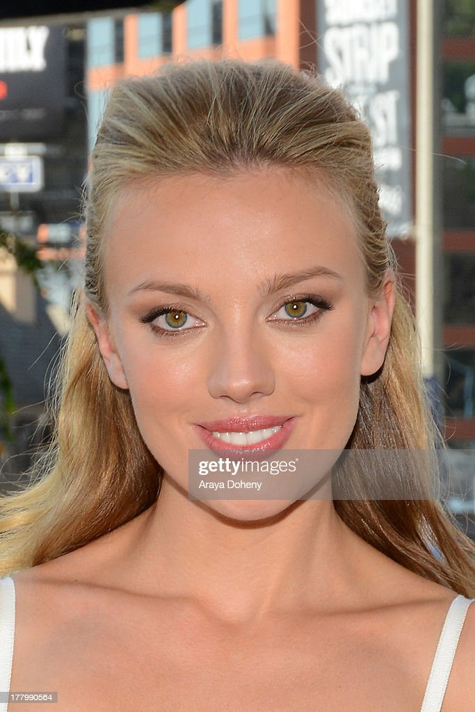 Actress <a gi-track='captionPersonalityLinkClicked' href=/galleries/search?phrase=Bar+Paly&family=editorial&specificpeople=5598732 ng-click='$event.stopPropagation()'>Bar Paly</a> poses in front of the billboard promoting the Blu-ray and DVD debut of 'Pain & Gain' on the Sunset Strip on August 26, 2013 in West Hollywood, California.