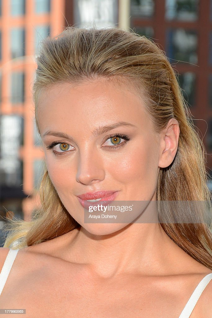 Actress Bar Paly poses in front of the billboard promoting the Blu-ray and DVD debut of 'Pain & Gain' on the Sunset Strip on August 26, 2013 in West Hollywood, California.