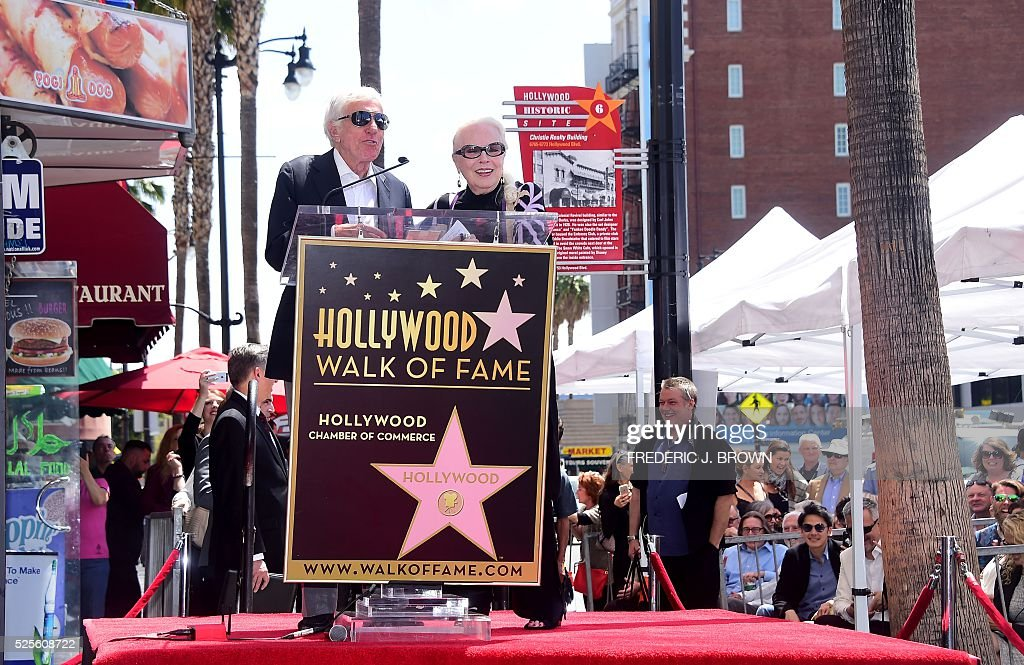 US actress Barbara Bain is joined by actor Dick Van Dyke during the ceremony for her Hollywood Walk of Fame Star in Hollywood, California, on April 28, 2016. / AFP / FREDERIC
