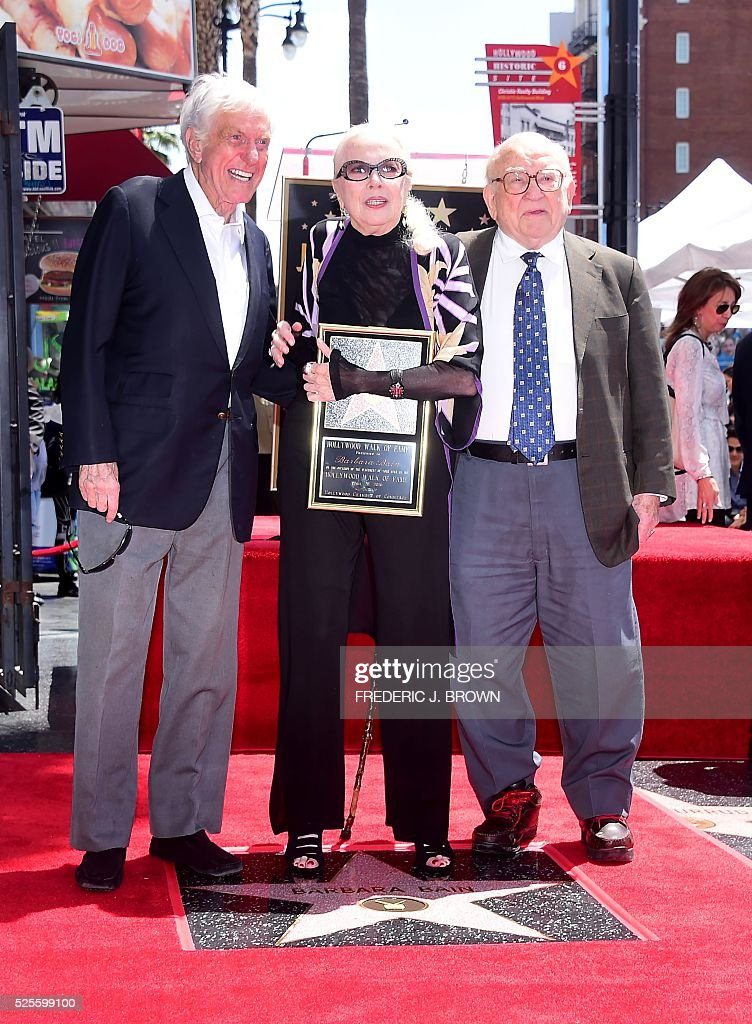 US actress Barbara Bain (C) is joined by actors Dick Van Dyke (L) and Ed Asner (R) as she is honored with a Hollywood Walk of Fame Star in Hollywood, California, on April 28, 2016. / AFP / FREDERIC
