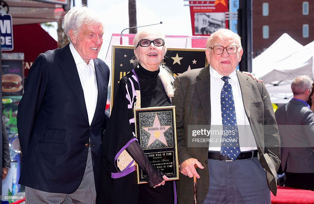 US actress Barbara Bain (C) is joined by actors Dick Van Dyke (L) and Ed Asner (R) as she is honored with a star on the Hollywood Walk of Fame in Hollywood, California, on April 28, 2016. / AFP / FREDERIC