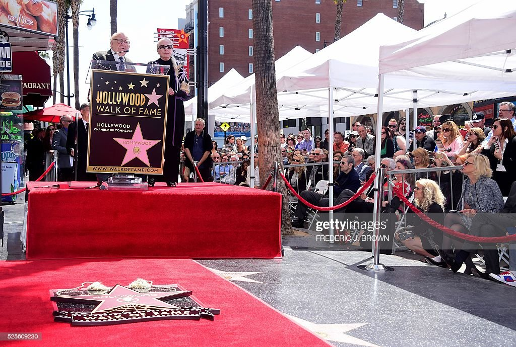 US actress Barbara Bain listens as actor Ed Asner speaks during the ceremony for her Hollywood Walk of Fame Star in Hollywood, California on April 28, 2016. / AFP / FREDERIC