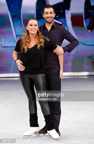 Actress Barbara De Rossi and her skating partner Simone Vaturi pose during the 'Notti Sul Ghiaccio' TV Show photocall at RAI Studios on February 18...