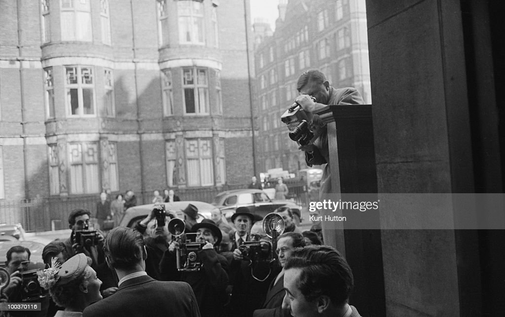 Actress Barbara Murray leaves Marylebone Register Office in London after her wedding to actor John Justin (1917 - 2002), March 1952. Original Publication : Picture Post - 5823 - TV's First Star Gets Married - pub. 29th March 1952