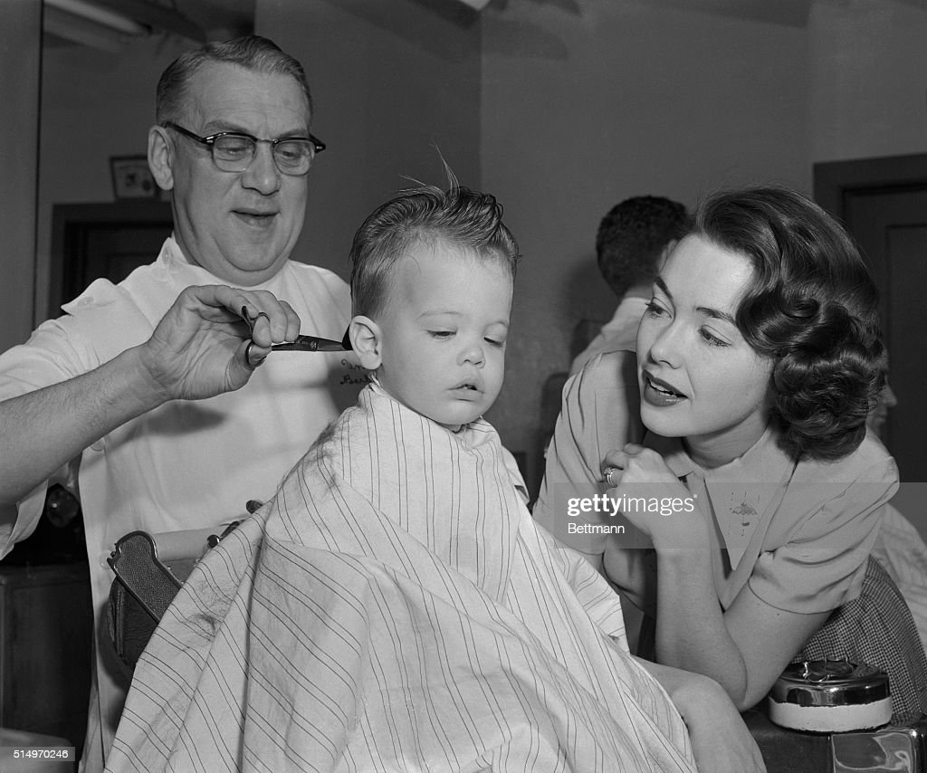 Actress Barbara Rush accompanies her son Christopher Merrill Hunter to the UniversalInternational Studio barber shop for his first visit to the...