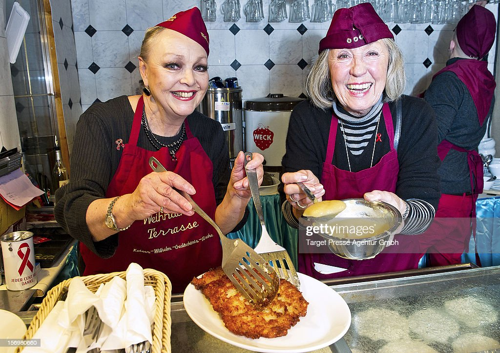 Actress Barbara Schoene and Roswitha Voelz attend the 'Kartoffelpuffer-Brat-Charity' at the Berlin Christmas Market on November 26, 2012 in Berlin, Germany.