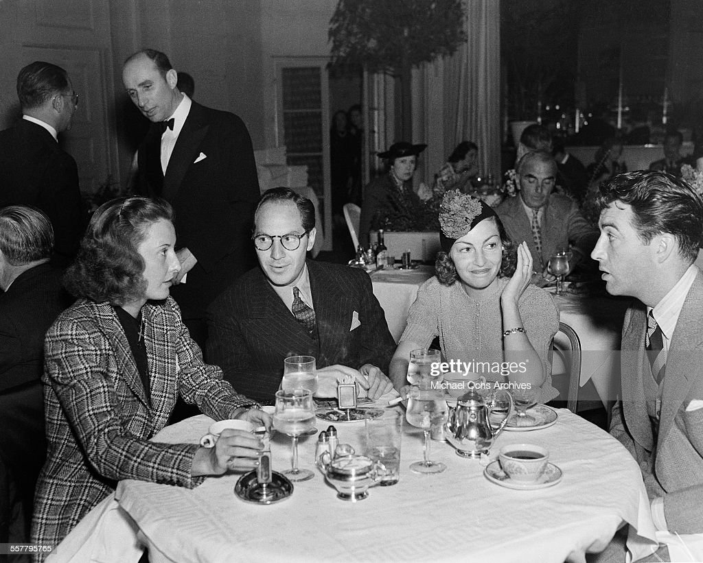 Actress <a gi-track='captionPersonalityLinkClicked' href=/galleries/search?phrase=Barbara+Stanwyck&family=editorial&specificpeople=90352 ng-click='$event.stopPropagation()'>Barbara Stanwyck</a> (L) and her husband actor <a gi-track='captionPersonalityLinkClicked' href=/galleries/search?phrase=Robert+Taylor+-+American+Actor&family=editorial&specificpeople=5411922 ng-click='$event.stopPropagation()'>Robert Taylor</a> (R) have dinner with friends in Los Angeles, California.