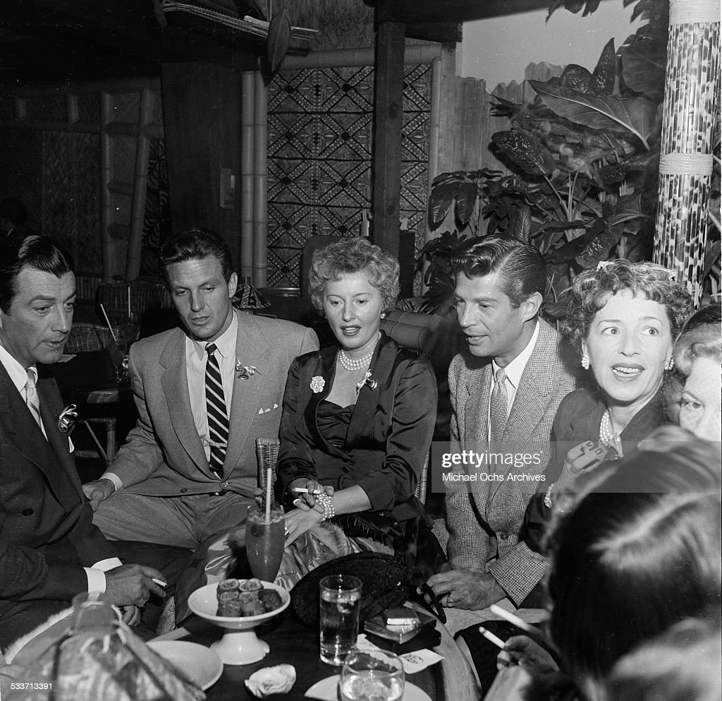 Actress <a gi-track='captionPersonalityLinkClicked' href=/galleries/search?phrase=Barbara+Stanwyck&family=editorial&specificpeople=90352 ng-click='$event.stopPropagation()'>Barbara Stanwyck</a> with husband <a gi-track='captionPersonalityLinkClicked' href=/galleries/search?phrase=Robert+Taylor+-+American+Actor&family=editorial&specificpeople=5411922 ng-click='$event.stopPropagation()'>Robert Taylor</a> (far left) and <a gi-track='captionPersonalityLinkClicked' href=/galleries/search?phrase=Robert+Stack&family=editorial&specificpeople=213357 ng-click='$event.stopPropagation()'>Robert Stack</a> attend a cocktail party for the Hollywood Press Club in Los Angeles,CA.