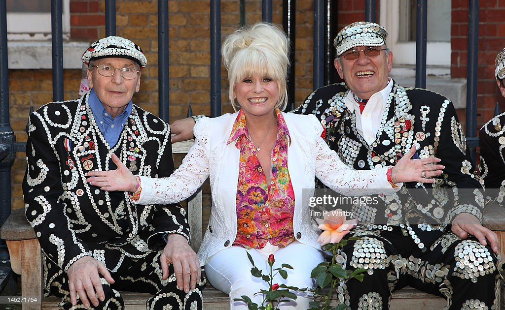 Actress <a gi-track='captionPersonalityLinkClicked' href=/galleries/search?phrase=Barbara+Windsor&family=editorial&specificpeople=210539 ng-click='$event.stopPropagation()'>Barbara Windsor</a> (C) poses 'pearly kings' while launching the appeal to save the gardens at St Paul's parish church, Covent Garden on May 25, 2012 in London, United Kingdom. The appeal aims to raise funds towards the GBP £100,000 cost of repairs to land subsidence of the church's gardens caused by the collapse of underground vaults. St Paul's is also known as the 'actors' church' due to its location in the heart of London's West End.