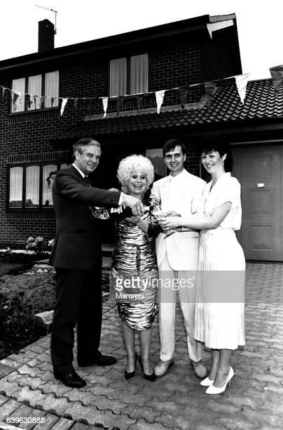 Actress Barbara Windsor proposes a housewarming toast to DIY builders Allan and Linda Richards 7 June 1987 Alan and Linda were among a street full of...