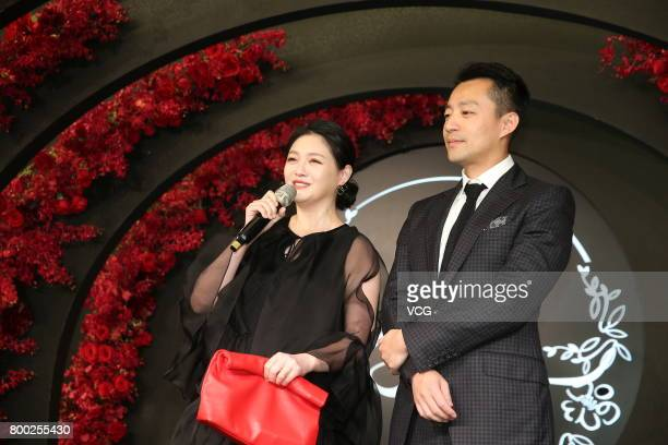 Actress Barbie Hsu and her husband Wang Xiaofei arrive at the red carpet of the banquet held by Macau businessman Levo Chan and actress Ady An on...