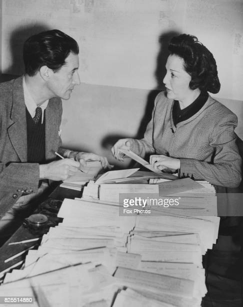 Actress Bebe Daniels and composer Ivor Novello addressing envelopes to Equity members at the Arts Club Leicester Square London asking them to support...
