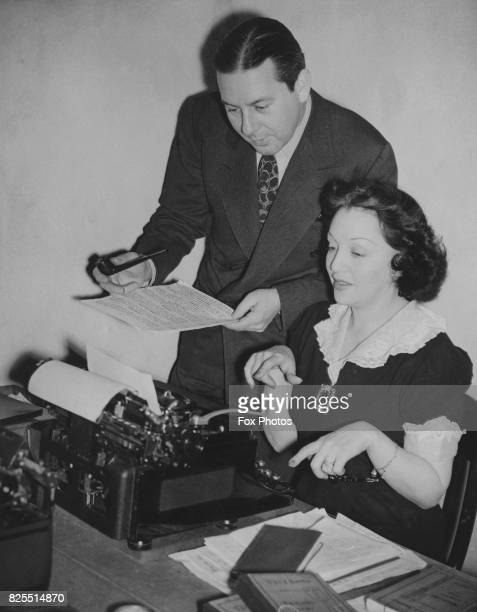 Actress Bebe Daniels and her husband actor Ben Lyon working on the script for the BBC radio programme 'Hi Gang' 17th January 1941