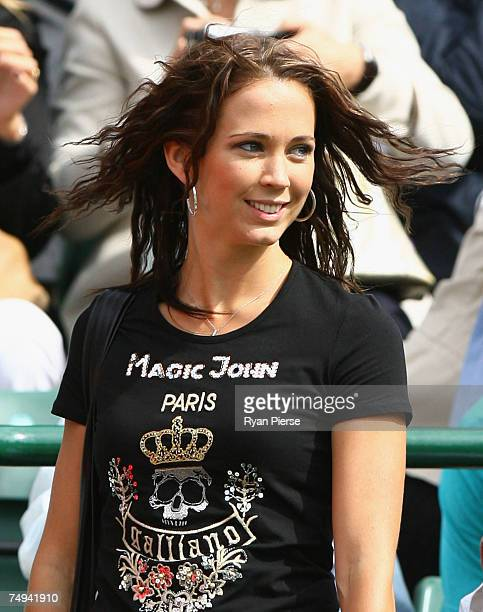 Actress Bec Cartwright partner of Lleyton Hewitt of Australia looks on during his Men's Singles second round match against Simone Bolelli of Italy...