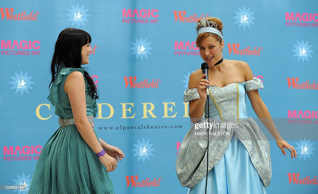 Actress Becky Baeling (R) introduces a performer during the talent search for the next 'Cinderella' at Culver City in Los Angeles on July 14, 2010. The winner of the search will appear as the lead in 'Cínderella, A Modern Magical Musical Extravaganza' that will be produced by Nigel, Bonnie, and Kris Lythgoe, who also produce 'So You Think You Can Dance', 'Dancing With The Stars' and 'American Idol'. AFP PHOTO/Mark RALSTON