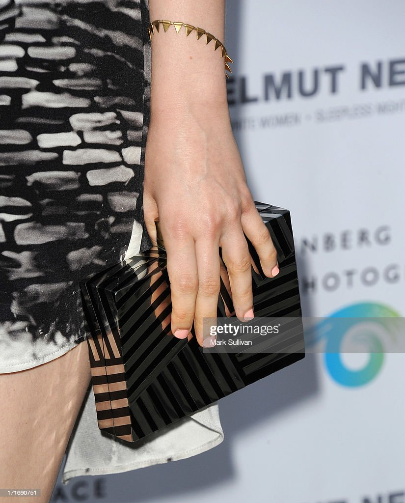 Actress Bella Heathcote (handbag and jewelry detail) at the opening of 'Helmut Newton: White Women - Sleepless Nights - Big Nudes' at at Annenberg Space For Photography on June 27, 2013 in Century City, California.