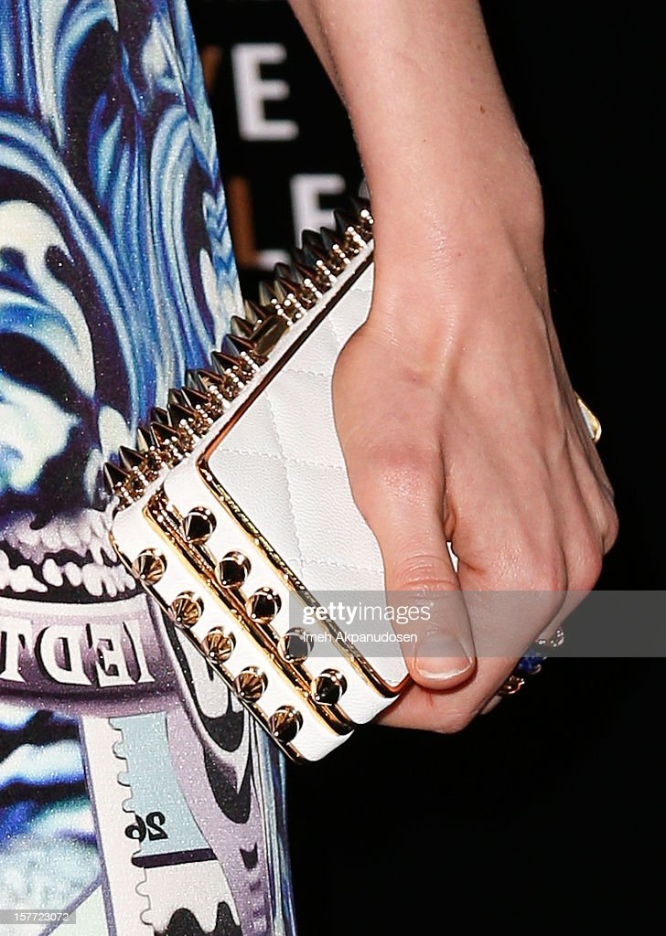 Actress Bella Heathcote (clutch detail) attends the Rodeo Drive Walk Of Style honoring BVLGARI and Mr. Nicola Bulgari held at Bulgari on December 5, 2012 in Beverly Hills, California.