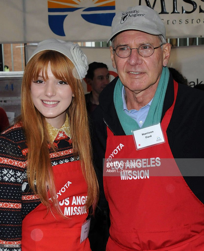 Actress Bella Thorne and actor Harrison Ford participate in the Los Angeles Mission Christmas Eve lunch For The Homeless held at the Los Angeles Mission on December 24, 2012 in Los Angeles, California.