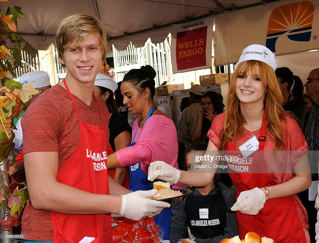 Actress <a gi-track='captionPersonalityLinkClicked' href=/galleries/search?phrase=Bella+Thorne&family=editorial&specificpeople=5083663 ng-click='$event.stopPropagation()'>Bella Thorne</a> and actor Tristan Klier participate in Kirk And Anne Douglas' 8th Annual Thanksgiving For Skid Row Homeless at The Los Angele Mission held at Los Angeles Mission on November 21, 2012 in Los Angeles, California.