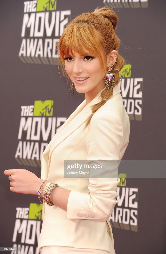 Actress Bella Thorne arrives at the 2013 MTV Movie Awards at Sony Pictures Studios on April 14, 2013 in Culver City, California.
